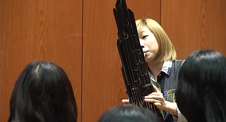 In Taiwan, a woman plays the Super Mario Bros. theme on a Sheng