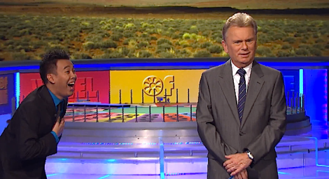 Contestant amazingly solves puzzle in the bonus round of Wheel of Fortune as Pat Sajak looks on
