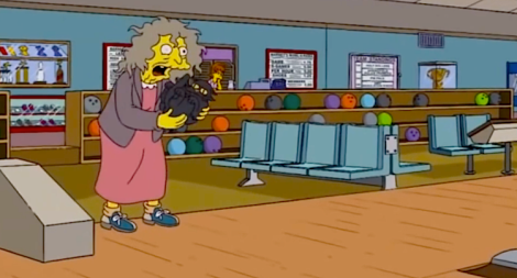 The Simpsons' crazy cat lady (Screen shot from http://youtu.be/ljGpJ_1jhTw)